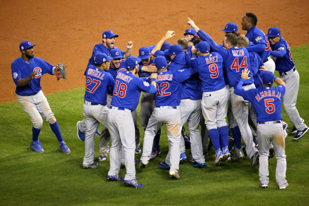 photo courtesy of flickr.com  the victorious Chicago Cubs celebrate their first World Series win in a century.
