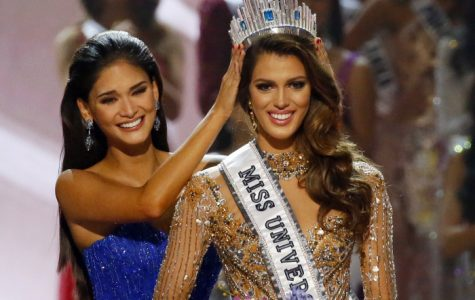 Iris Mittenaere of France is crowned the new Miss Universe 2016 by 2015 Miss Universe Pia Wurtzbach in coronation Monday, Jan. 30, 2017, at the Mall of Asia in suburban Pasay city, south of Manila, Philippines.