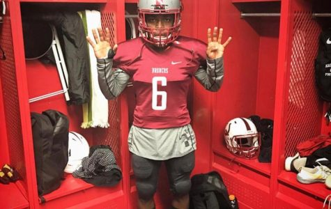Former Wildcat Darius Maxwell poses in uniform before a game at Hastings College in Nebraska.