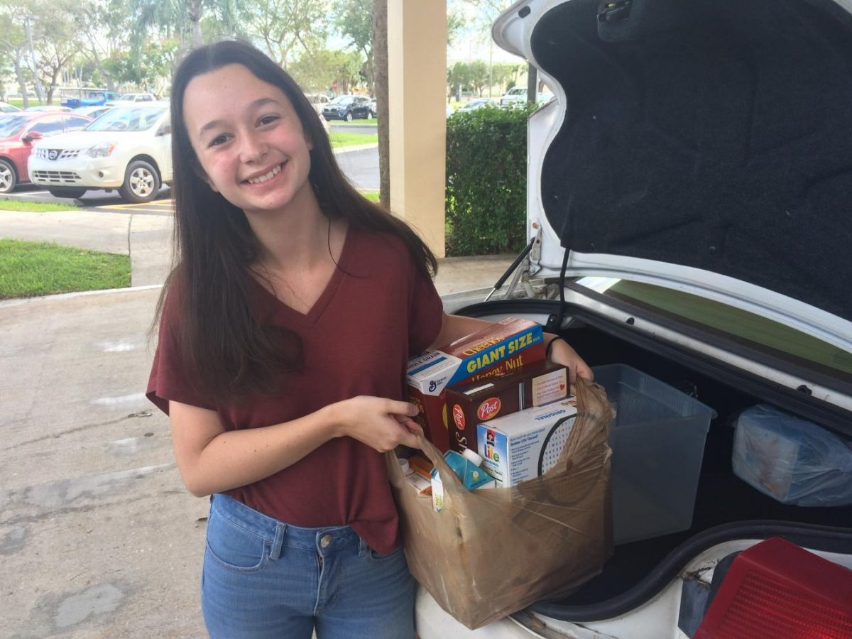 Senior+Agustina+Vincent+drops+off+items+donated+to+the+National+Honor+Society+charity+drive+at+St.+Bonaventure+Catholic+Church+on+Sept.+23.+%0A