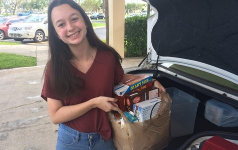 Senior Agustina Vincent drops off items donated to the National Honor Society charity drive at St. Bonaventure Catholic Church on Sept. 23.