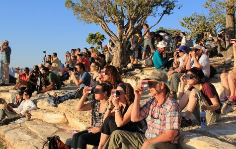 People view the eclipse through protective glasses at Grand Canyon National Park on August 21.