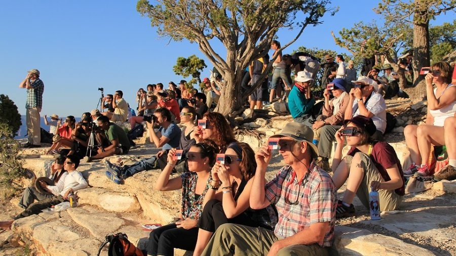 People+view+the+eclipse+through+protective+glasses+at+Grand+Canyon+National+Park+on+August+21.+%0A