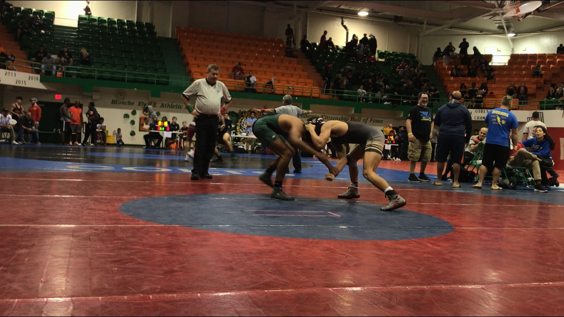 Junior Daniel Ellison (right) wrestles Flanagan opponent (left) at the BCAA championship tournament on Jan. 26.