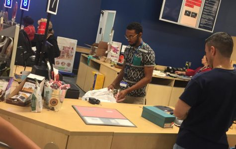 Senior Jaiden Moses checks out a customer during a shift at Marshalls.