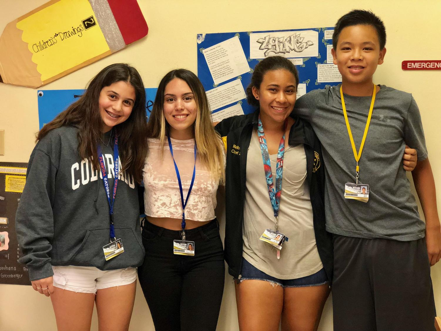 Students Lauren Schwartz, Sophia Vasquez, Marisa Moo Young and Nathan Nguyen display their daily worn IDs.