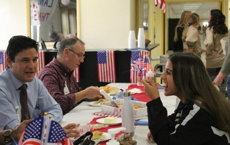 Junior Genevieve Perez and veteran Anthony  Leventhal enjoy the Veterans Day lunch on November 9.
