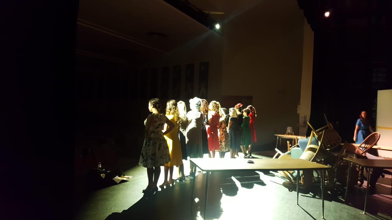 The cast is backlit by lighting directors Cory Gershengorn and Frankie Ferrer during the Nov. 7 dress rehearsal to emphasize the tension of the scene.