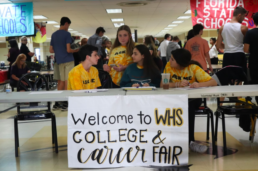 Student Government juniors Noah Katz, Kayla Butter, Liora Tuchman and Gabrielle Skolnick  welcome incoming guests to the Oct. 30 2019 College and Career Fair.
