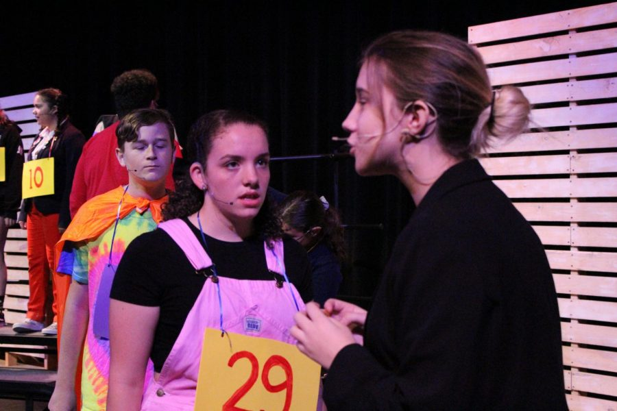 Sophomores+Aubrey+Odom%2C+Judy+Boza+and+senior+Nicole+Ehrlich+preform+the+opening+number+of+%2725th+Annual+Putnam+County+Spelling+Bee%27+at+the+dress+rehearsal.+