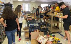 Student volunteers work in the portables in early November to organize incoming donations for the Harvest Drive.