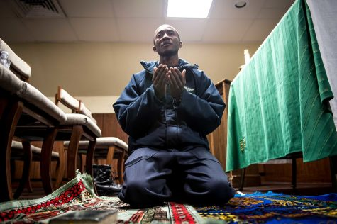 On board the aircraft carrier the USS Theodore Roosevelt, Abdul N. Alassan practices the Islamic faith during a prayer service held in the ship's mosque. As immigration detention centers face controversy on the conditions that their Muslims inmates are being kept many worry about the continuation of violating religious rights.