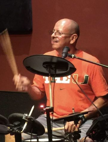 Social Studies Teacher Carlos Velasquez plays the drums in his cover band Smugglers Reef.