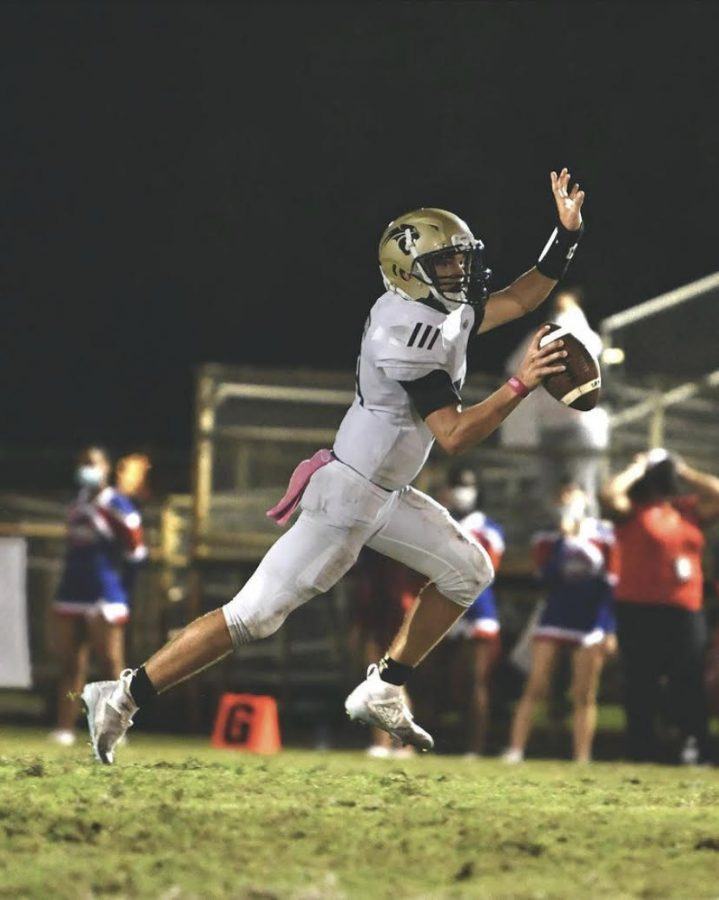 Quarterback+Collin+Hurst+starts+a+play+in+the+first+half+of+game+at+Plantation+High+School+on+Oct.+30.